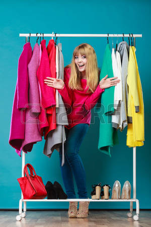 49008503-happy-woman-choosing-clothes-in-wardrobe-girl-customer-shopping-in-mall-shop-fashion-clothing-sale